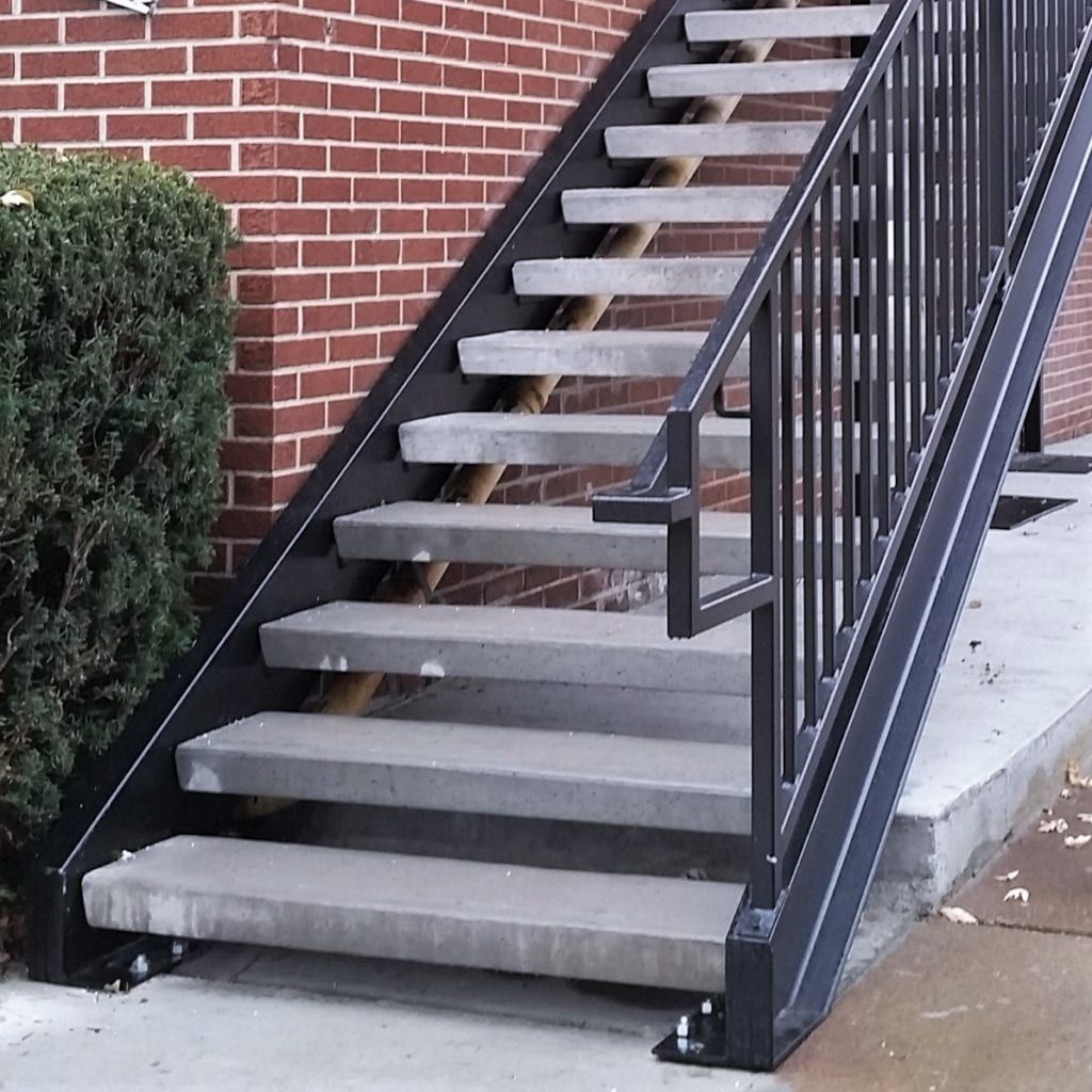 apartment staircase walkway new metal stairs rental living concrete treads wrought iron rail galvanized commercial stair stringers